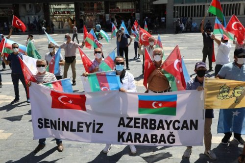 Activists hold flags of Turkey and Azerbaijan as they gather in Ankara, on August 8, 2020 [ADEM ALTAN/AFP via Getty Images]