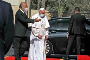 Pope Francis is welcomed by Iraqi President Barham Saleh at the presidential palace in Baghdad on March 5, 2021 on the first papal visit to Iraq. - Pope Francis began his historic trip to war-scarred Iraq, defying security concerns and the coronavirus pandemic to comfort one of the world's oldest and most persecuted Christian communities. (Photo by Sabah ARAR / AFP) (Photo by SABAH ARAR/AFP via Getty Images)