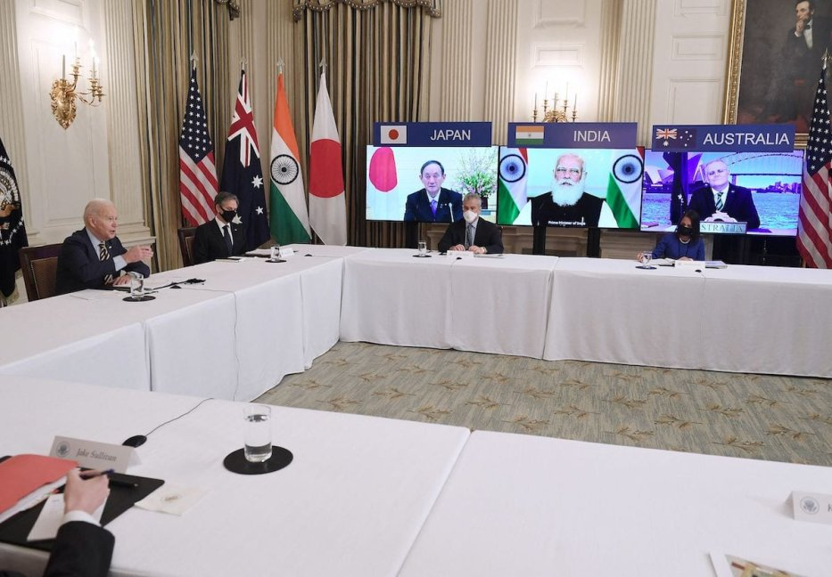 "US President Joe Biden (L), with Secretary of State Antony Blinken (2nd L), meets virtually with members of the ""Quad"" alliance of Australia, India, Japan and the US, in the State Dining Room of the White House in Washington, DC, on 12 March 2021. [OLIVIER DOULIERY/AFP via Getty Images]"
