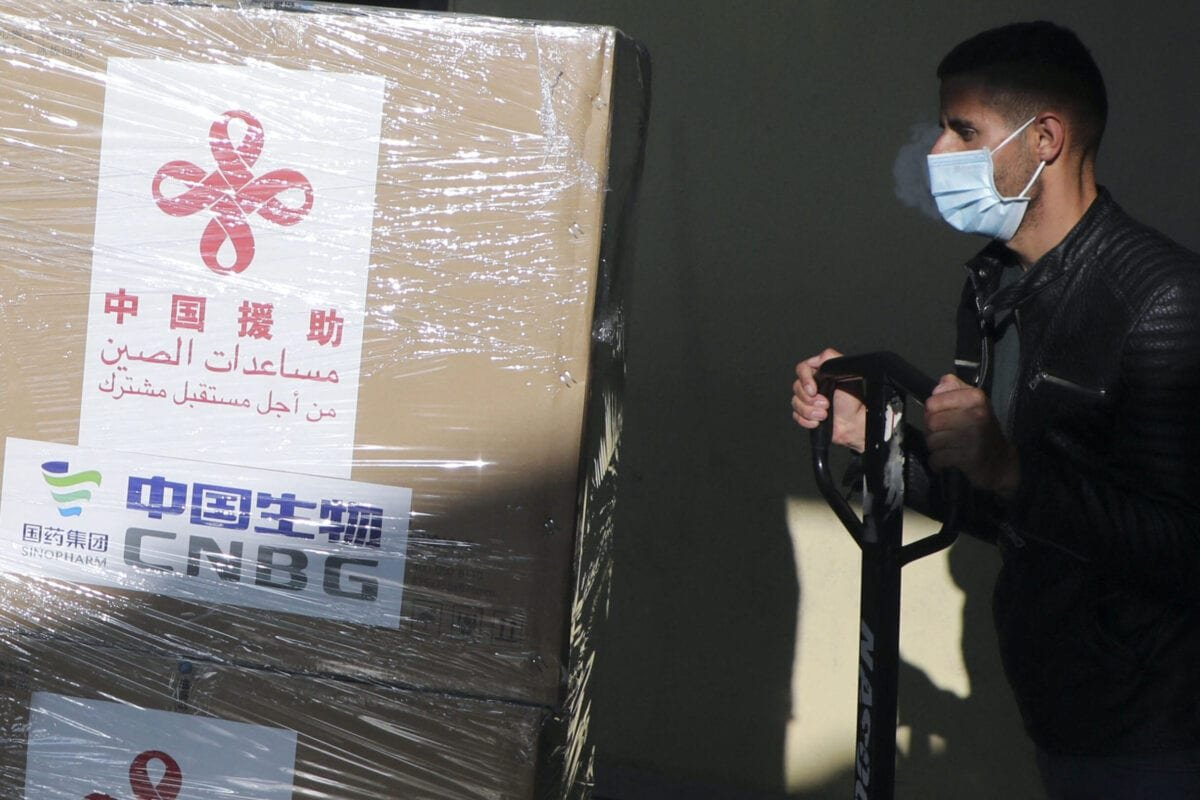 A Palestinian worker unloads a shipment of the Sinopharm COVID-19 vaccines donated by the Chinese government in the West Bank city of Nablus, on March 29, 2021. (Photo by JAAFAR ASHTIYEH / AFP) (Photo by JAAFAR ASHTIYEH/AFP via Getty Images)