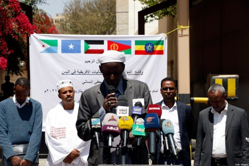Members of African communities stage a gathering and conference outside the International Organization for Migration on 13 March 2021 in Sana'a, Yemen. [Mohammed Hamoud/Getty Images]