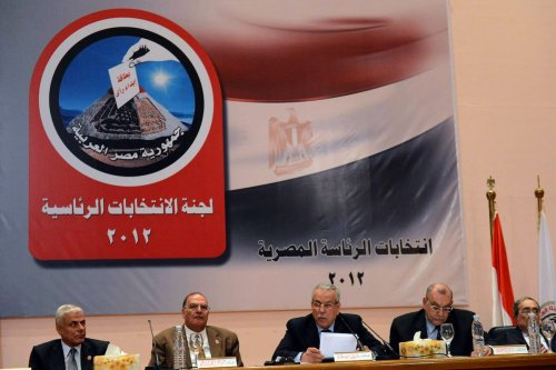 Faruq Sultan (3rd L), head of the elections presidential committee, speaks during a televised press conference where he announced the winner of the Egyptian presidential elections on 24 June 2012, in Cairo. [KHALED DESOUKI/AFP/GettyImages]