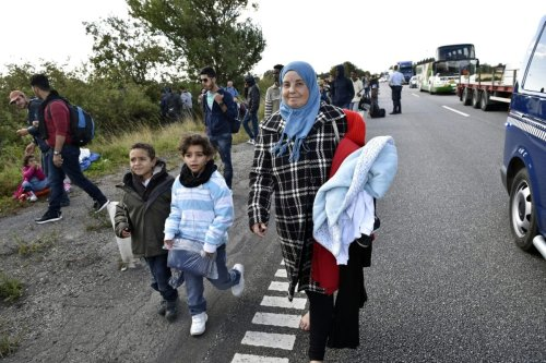 Migrants, mainly from Syria, walk on the highway 12km north of Rodby, Denmark moving to the north on September 7, 2015 [JENS NOERGAARD LARSEN/AFP via Getty Images]