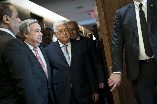 Following a meeting of the United Nations Security Council, Secretary-General of the United Nations Antonio Guterres (L) and President of Palestine and Palestinian National Authority Mahmoud Abbas arrive for a photo opportunity prior to a meeting at UN headquarters, on 20 February 2018 in New York City. [Drew Angerer/Getty Images]