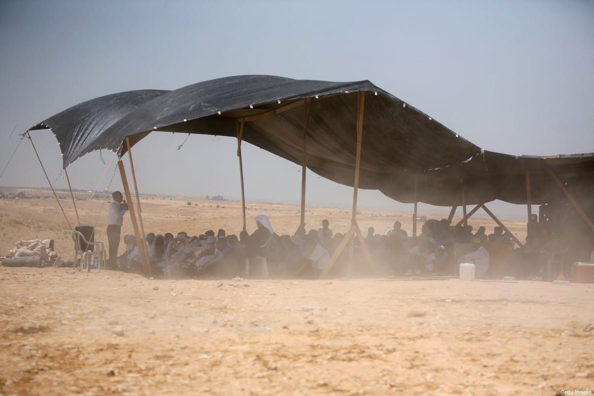 Bedouins attend Friday prayer under a tent in the Al-Araqeeb village, located between on 14 May 2010 [HAZEM BADER/AFP/Getty Images]