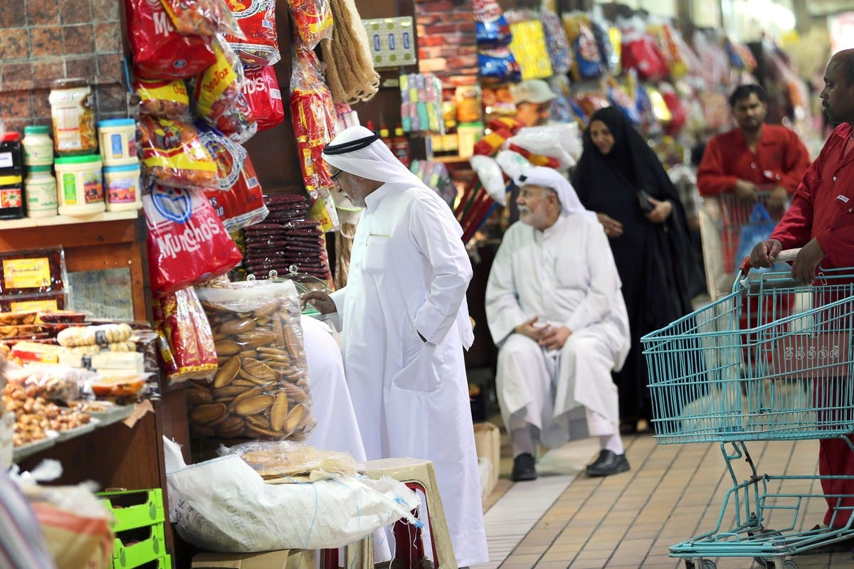 Kuwaitis shop at a market in Kuwait City on 12 June 2017 [YASSER AL-ZAYYAT/AFP/Getty Images]