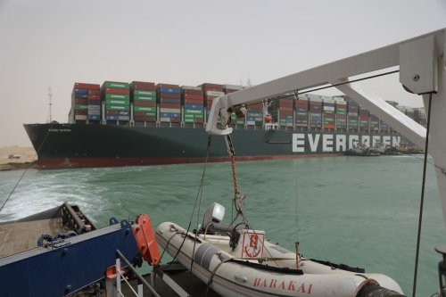Continuing the Floatation Works of the Grounding Vessel in the Suez Canal on 25 March 2021 [Suez Canal Media Center]