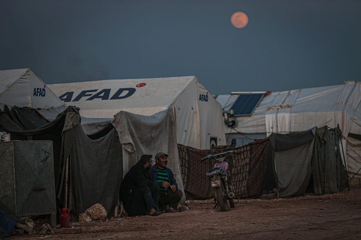 IDLIB, SYRIA - MARCH 28: Full moon rises over Maarrat Misrin camp in Idlib province, Syria on March 28, 2021. ( Muhammed Said - Anadolu Agency )