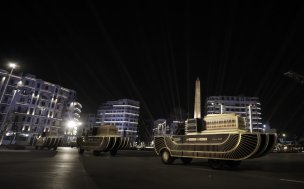 People wearing ancient Egyptian costumes take part in the ceremony as specially designed vehicles transport 22 mummies in a convoy from the Egyptian Museum to the new National Museum of Egyptian Civilization, during the Pharaohs' Golden Parade in Cairo, Egypt on April 03, 2021. [Stringer - Anadolu Agency]