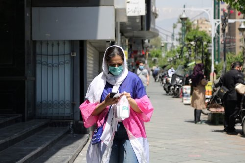 TEHRAN, IRAN - APRIL 17: A woman wears a face mask as a preventive measure against the coronavirus (COVID-19) as daily life continues in the country amid COVID-19 pandemic in Tehran, Iran, on April 17, 2021. ( Fatemeh Bahrami - Anadolu Agency )