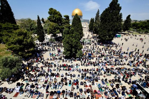 Muslims perform first Friday prayer of holy fasting month of Ramadan at Al-Aqsa Mosque compound in Jerusalem on 16 April 2021 [Mostafa Alkharouf/Anadolu Agency]
