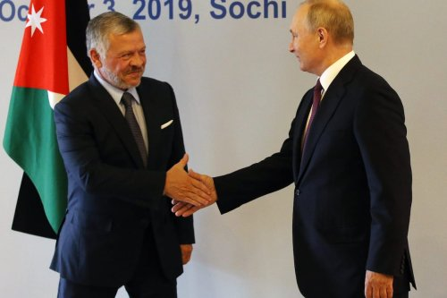 King of Jordan Abdullah II (L) and Russian President Vladimir Putin (R) shake hands during the Annual Meeting of Valdai International Discussion Club at mountain resort of Krasnaya Polyana in Sochi, Russia, on 3 October 2019. [Mikhail Svetlov/Getty Images]
