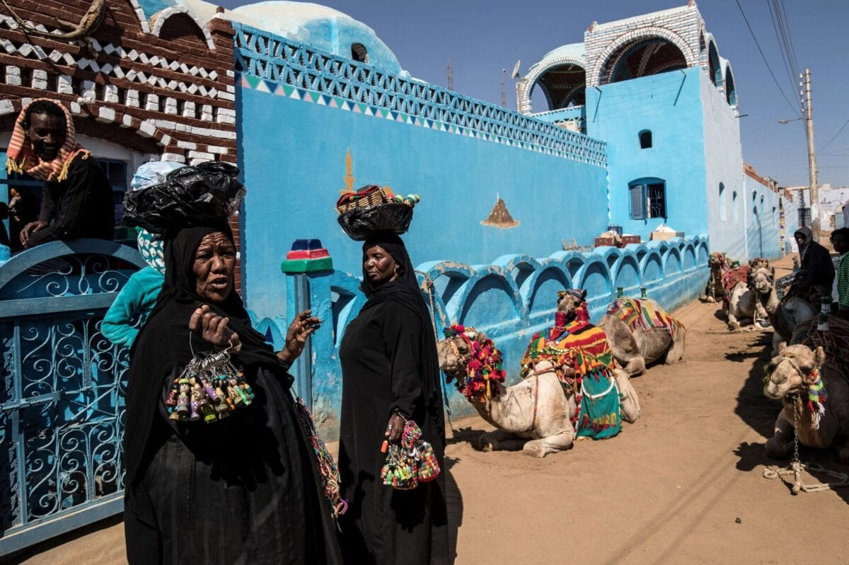 Nubian Egyptian women sell souvenirs in the village of Gharb Suhail near Aswan in Upper Egypt, some 920 kilometres south of the capital Cairo, on February 5, 2020 [KHALED DESOUKI/AFP via Getty Images]