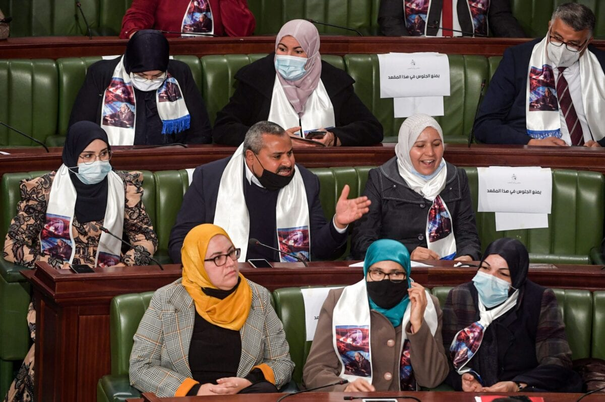 Members of the Ennahda Islamist bloc attend a parliamentary session in Tunis on January 26, 2021 [FETHI BELAID/AFP via Getty Images]