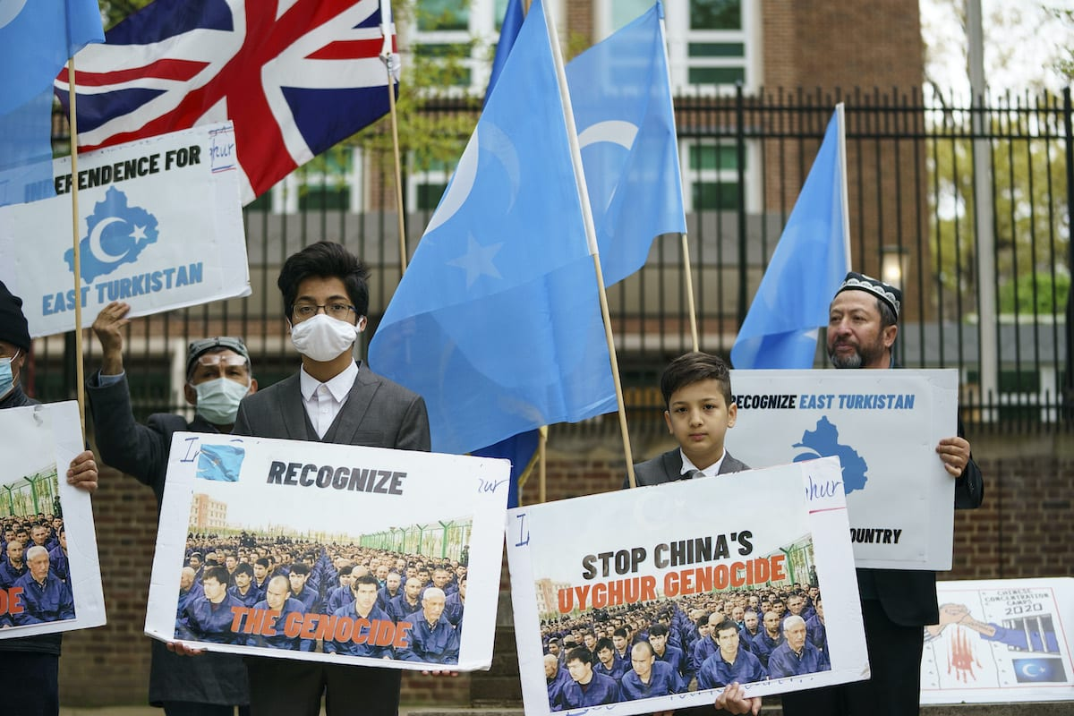 Supporters of the East Turkistan National Awakening Movement rally in front of the British Embassy ahead of an April 22 vote in the British House of Commons on whether or not to declare that a genocide is underway in Xinjiang province and Chinas treatment of the Uyghur Muslims on April 16, 2021 in Washington, DC. [Drew Angerer/Getty Images]