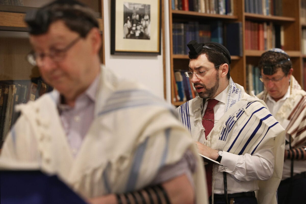Rabbis and members of the congregation pray during morning service at The Great Synagogue on December 17, 2020 [Lisa Maree Williams/Getty Images]
