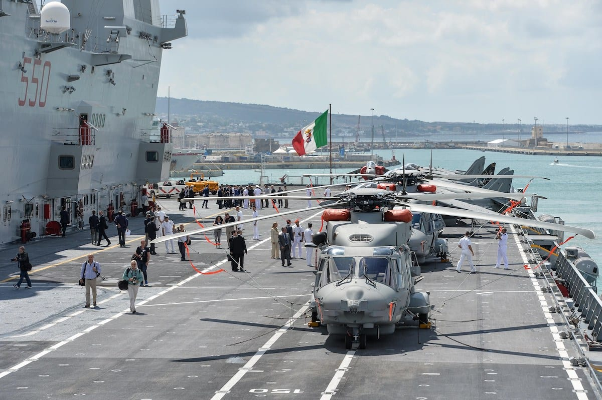 """Harrier jets and helicopters are parked on the flight deck of the Italian navy's aircraft carrier """"Cavour"""" in the Civitavecchia harbour on 8 July 2014. [ANDREAS SOLARO/AFP via Getty Images]"""