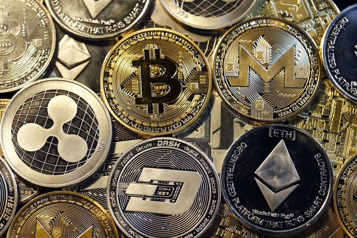 A visual representation of digital cryptocurrencies, Bitcoin, Ripple, Ethernum, Dash, Monero and Litecoin is displayed on 16 February 2018 in Paris, France. [Illustration by Chesnot/Getty Images]