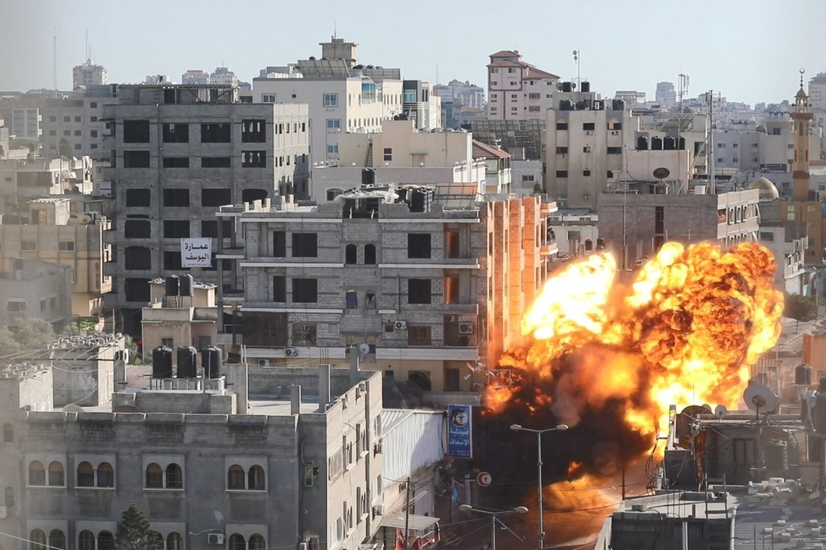 Israeli airstrike, on Palestinian production Bank amid a flare-up of Israeli-Palestinian violence, in Gaza City May 14, 2021 [Mohammed Asad/Middle East Monitor]