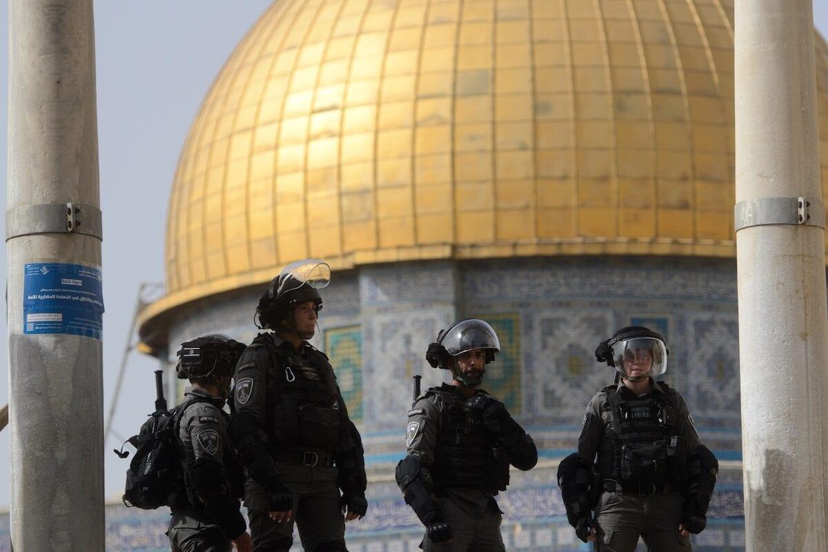 Israeli police intervene in Palestinians, who were standing guard to prevent fanatic Jews to raid the Masjid al-Aqsa Compound, in East Jerusalem on May 10, 2021 [Muath Khatib/Anadolu Agency]