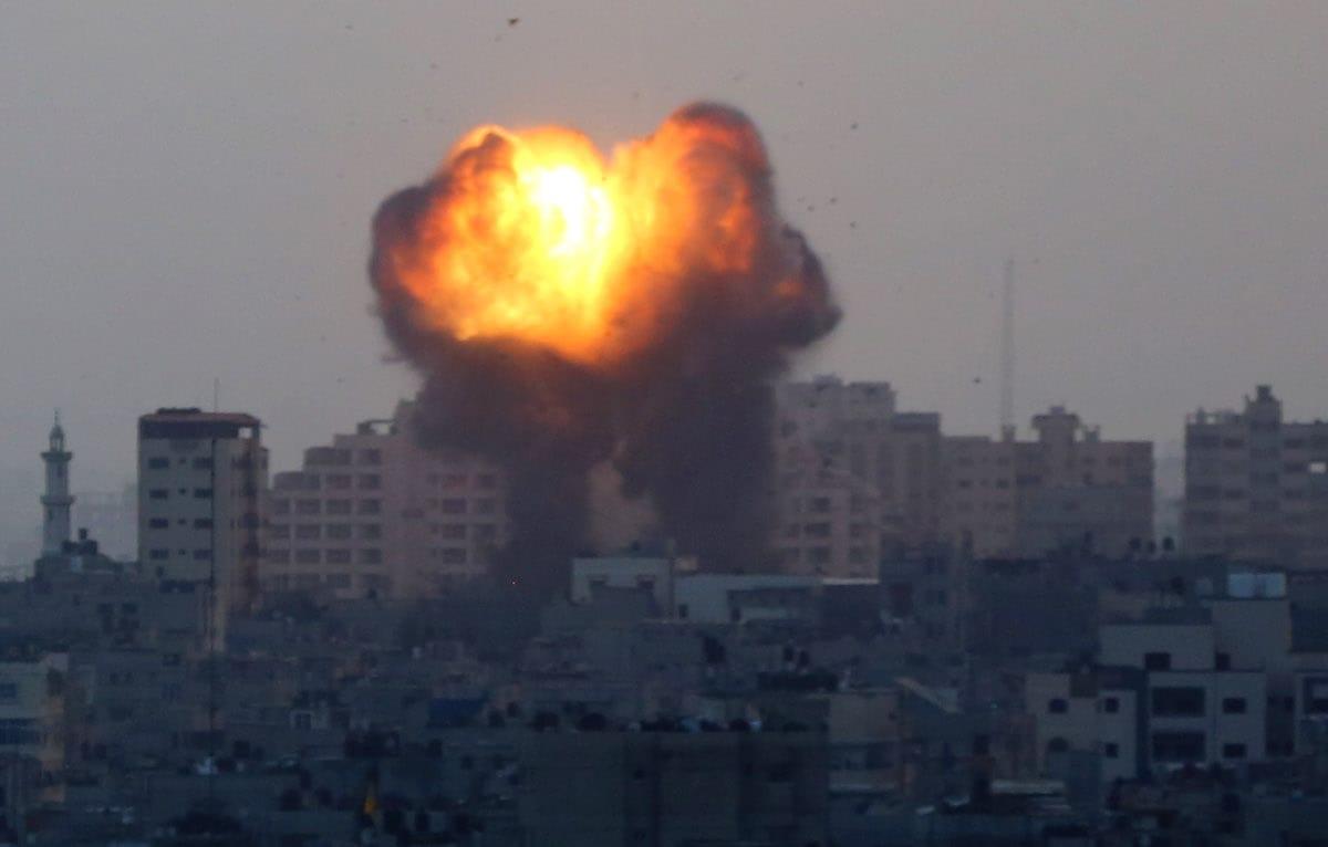 Smoke and flame rise after Israeli warplanes conducted airstrikes in Gaza City, Gaza on May 11, 2021 [Ashraf Amra/Anadolu Agency]