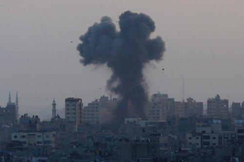GAZA CITY, GAZA - MAY 11: Smoke and flame rise after Israeli warplanes conducted airstrikes in Gaza City, Gaza on May 11, 2021. ( Ashraf Amra - Anadolu Agency )