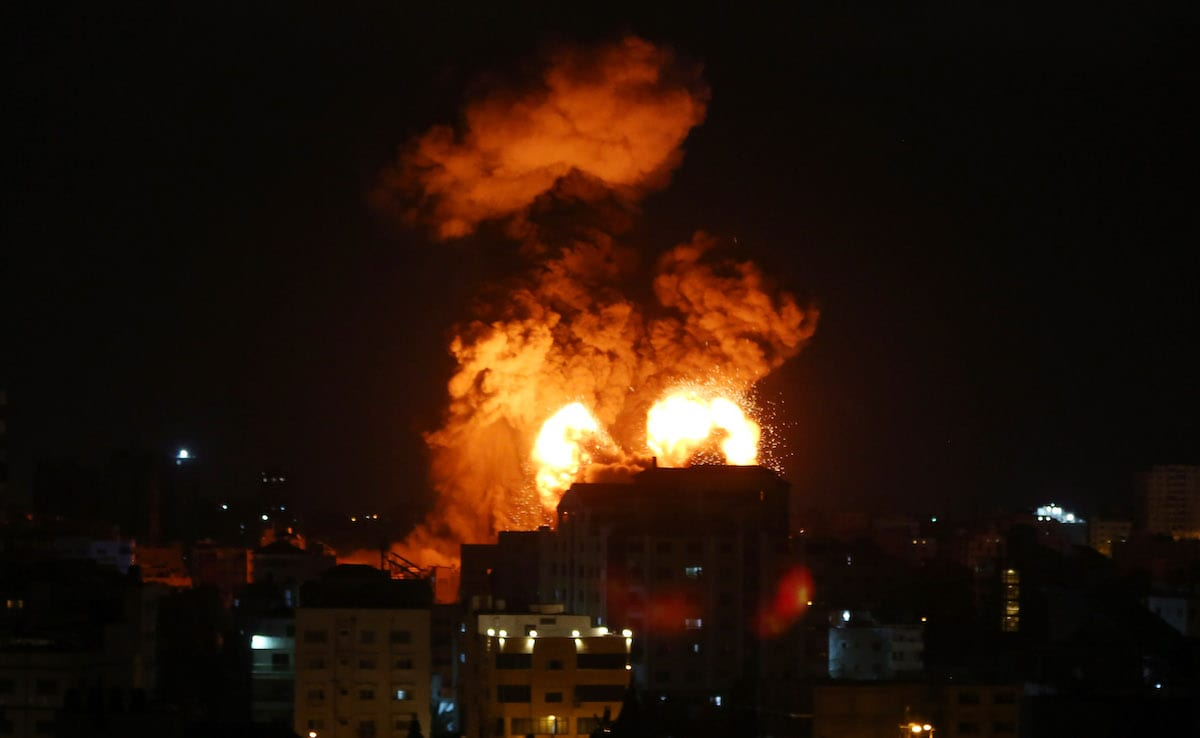 Smoke and flames rise after Israeli fighter jets conducted airstrikes in Gaza City, Gaza on May 13, 2021 [Ashraf Amra - Anadolu Agency]