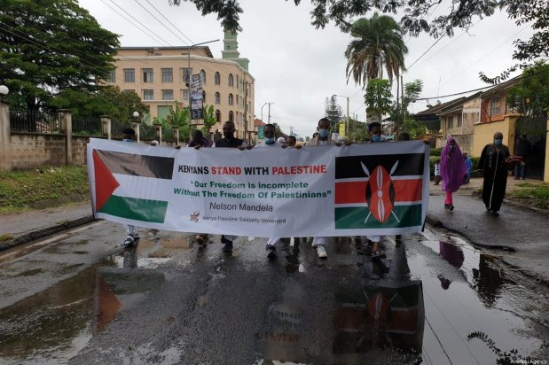 Kenyans gather for a protest against Israeli forces' attacks on Al-Aqsa Mosque and Gaza Strip after performing the Eid-Al Fitr prayer in Nairobi, Kenya on May 13, 2021 [Urban Shihemi / Anadolu Agency]