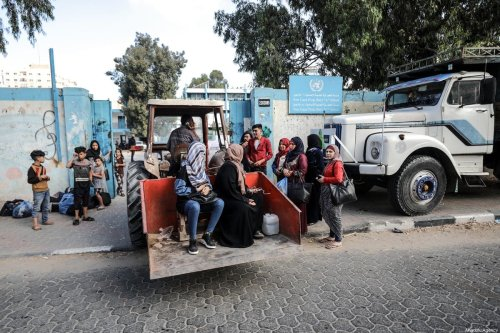Palestinian families, fleeing from their homes, are on their way to take shelter in an UN school, as Israeli forces continue to pound Gaza Strip on May 14, 2021, in Gaza City, Gaza [Ali Jadallah / Anadolu Agency]