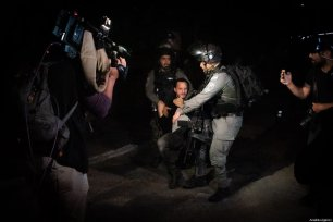 Israeli forces detain Palestinians in the Sheikh Jarrah neighbourhood of East Jerusalem on May 14, 2021. There has been clashes between Jewish settlers and Palestinians who were trying to forcibly evict Palestinian families from their homes in the Sheikh Jarrah neighbourhood of East Jerusalem [Eyad Tawil / Anadolu Agency]