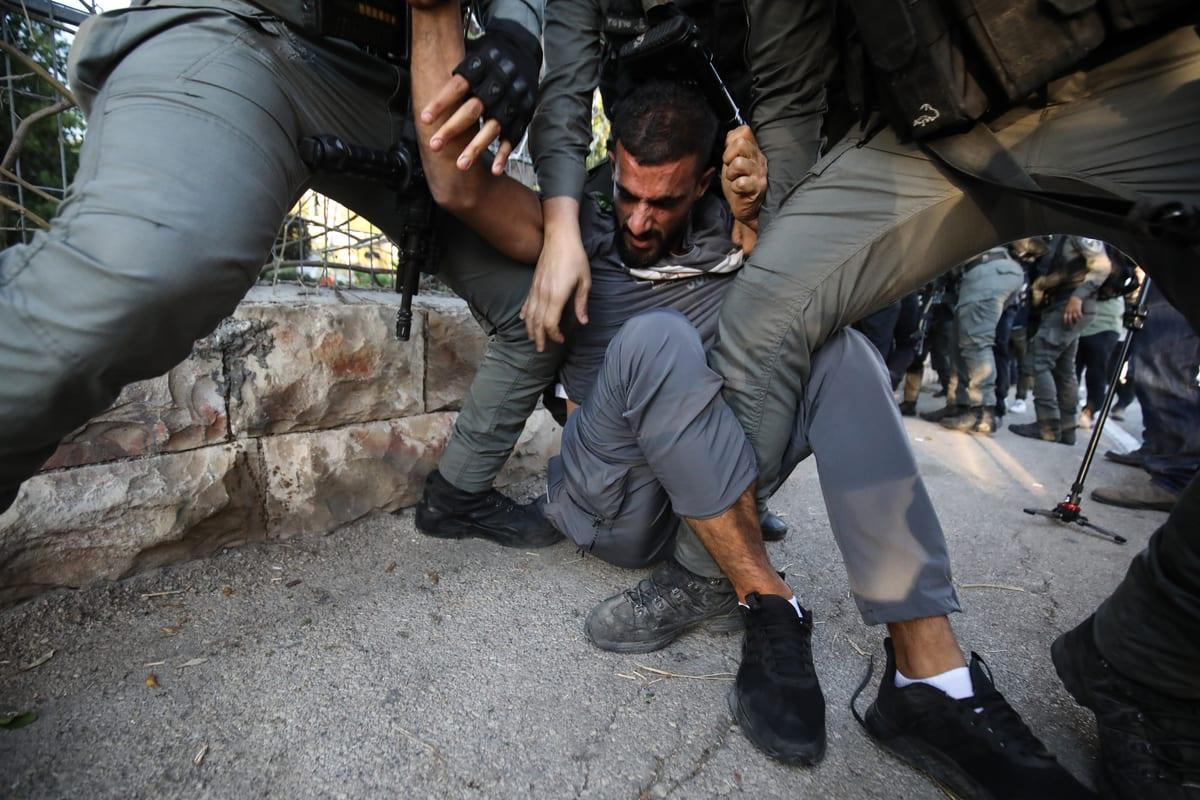 Israeli forces arrest a Palestinian man during a protest in Sheikh Jarrah neighbourhood of East Jerusalem on 15 May 2021 [Mostafa Alkharouf/Anadolu Agency]