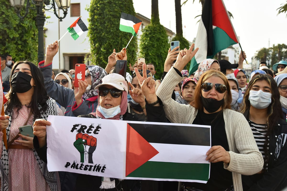 People gather to stage a demonstration in support of Palestinians and to protest against Israeli attacks on Gaza Strip, on 15 May 2021 in Rabat, Morocco. [Jalal Morchidi - Anadolu Agency]