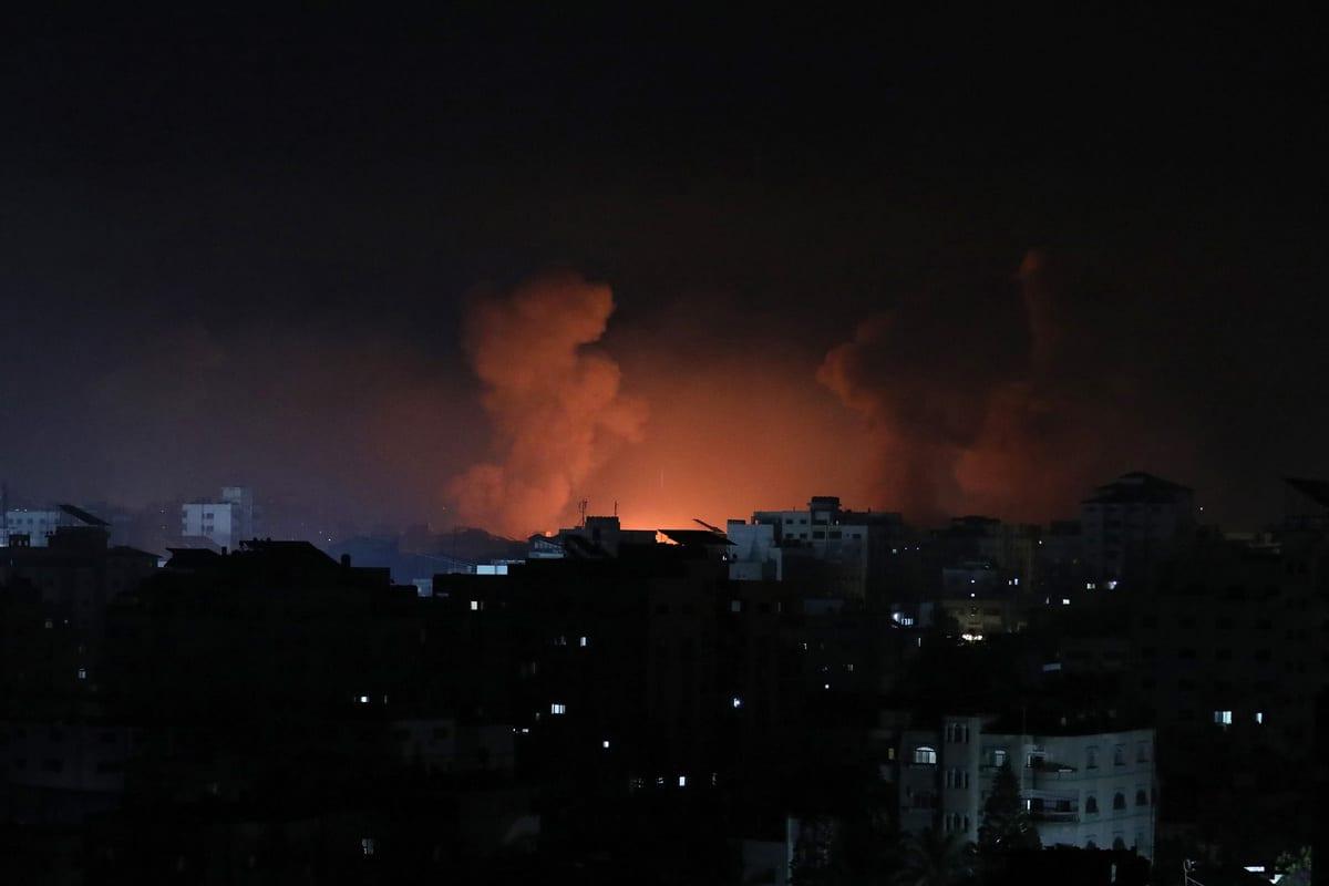 GAZA CITY, GAZA - MAY 16: Smokes rise after airstrikes by Israeli army hit buildings in Gaza City, Gaza on May 16, 2021. ( Mustafa Hassona - Anadolu Agency )