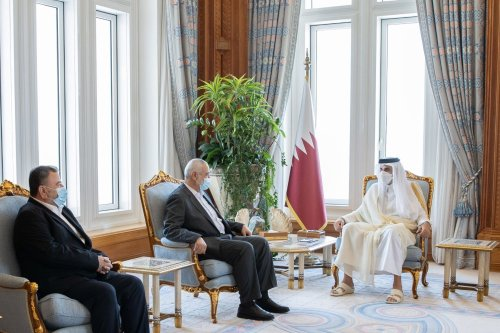Qatari Emir Sheikh Tamim bin Hamad al-Thani (R) meets Chairman of the Hamas Political Bureau Ismail Haniyeh (2nd L), in Doha, Qatar on May 23, 2021 [Qatari Emirate Council/Anadolu Agency]