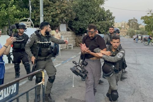 Israeli forces, who raided the panel, intervene in the Palestinians and detained 4 people, including two press members, in Sheikh Jarrah neighborhood of East Jerusalem on 27 May 2021. [Mostafa Alkharouf - Anadolu Agency]