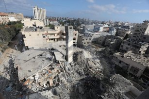 Israeli air strikes level a 6-storey residential building which was also home to the Nafha Centre for Israeli Studies in Gaza City [Mohammed Asad/Middle East Monitor]