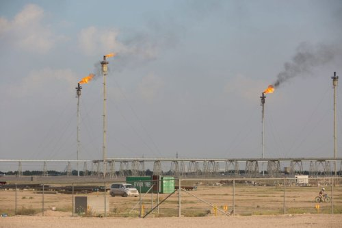 This picture shows gas flares at the Basrah Gas Company's (BGC) facilities in Basra on February 11, 2019 [HUSSEIN FALEH/AFP via Getty Images]