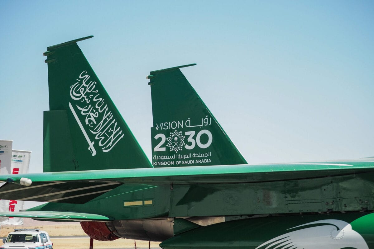 A Royal Saudi Air Force F-15 military fighter jet displays a 'Vision 2030' logo on its tail fin at the Saudi Air Show at Al Thumamah airport in Riyadh, Saudi Arabia, on Tuesday, March 12, 2019 [Ryan Olson/Bloomberg via Getty Images]