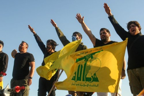 Supporters of the Lebanese Shiite movement Hezbollah on 25 May 2020 [MAHMOUD ZAYYAT/AFP/Getty Images]
