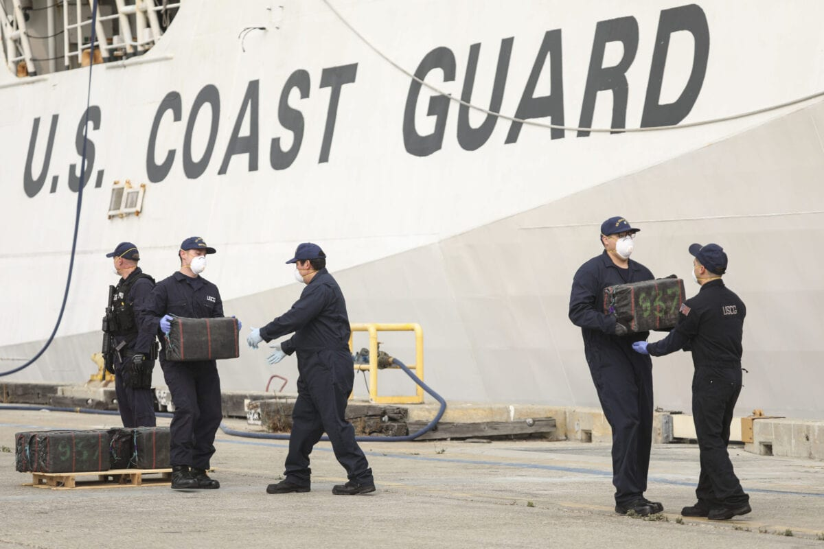 US Coast Guard personel unload bundles of seized drugs in front of the Cutter Bertholf on September 10, 2020 in San Diego, California [SANDY HUFFAKER/AFP via Getty Images]