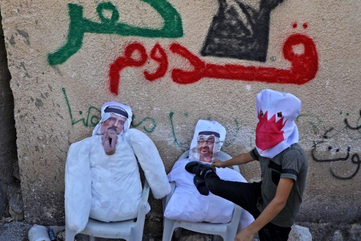 A Palestinian protester kicks effigies depicting (L) Bahrain's King Hamad bin Isa Al-Khalifa and Abu Dhabi's Crown Prince Sheikh Mohammed bin Zayed al-Nahyan during a demonstration in the village of Kfar Qaddum on September 25, 2020 [JAAFAR ASHTIYEH/AFP via Getty Images]
