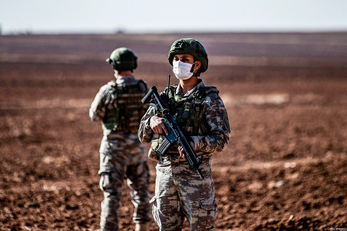 Turkish soldiers stand guard during a joint Russian-Turkish patrol in the eastern countryside of the town of Darbasiyah near the border with Turkey in Syria's northeastern Hasakah province on December 7, 2020 [DELIL SOULEIMAN/AFP via Getty Images]