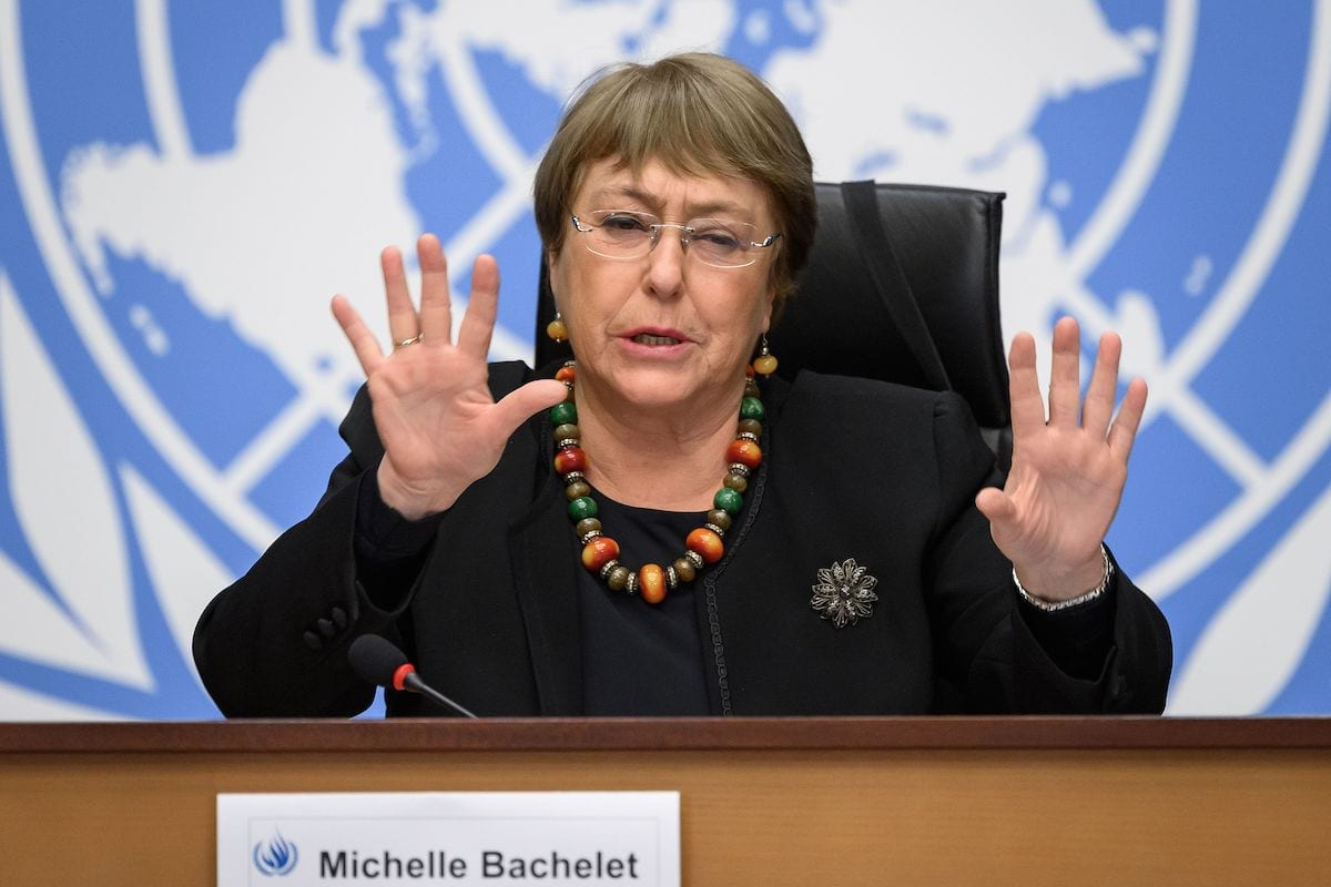UN High Commissioner for Human Rights Michelle Bachelet gestures at a press conference on 9 December 2020 in Geneva. [FABRICE COFFRINI/AFP via Getty Images]