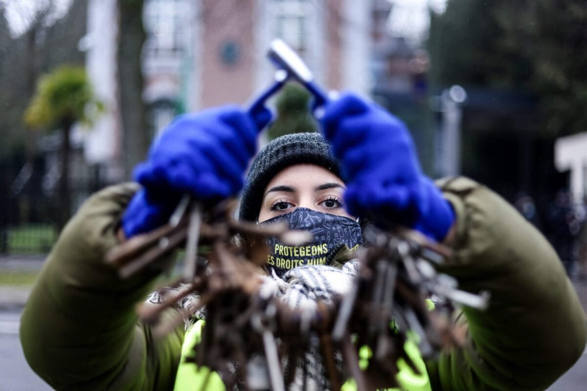An activist of the human rights NGO Amnesty International takes part in an action in front of the embassy of Saudi Arabia in Brussels on January 8, 2021 [KENZO TRIBOUILLARD/AFP via Getty Images]