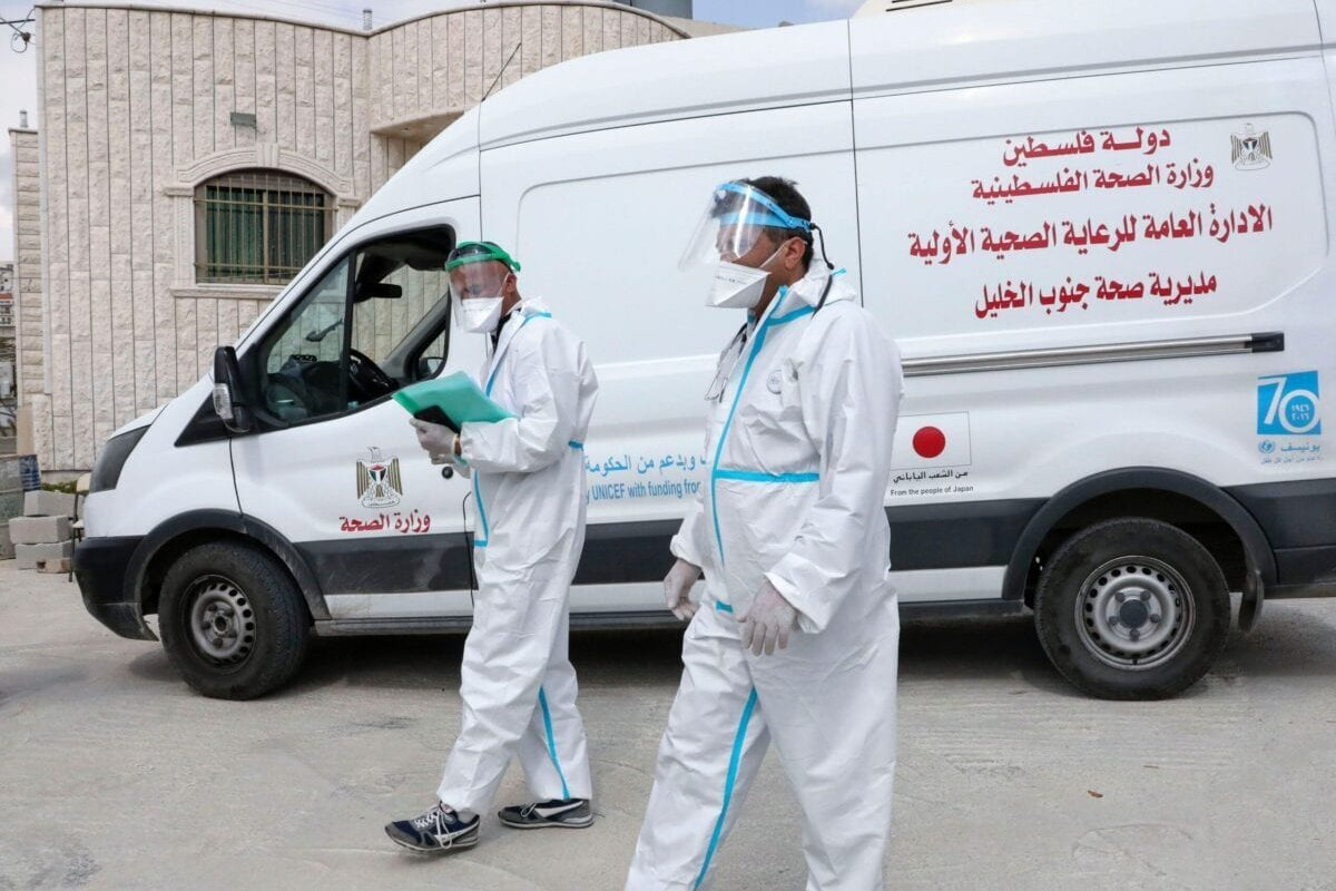 Doctors affiliated with the Palestinian ministry of health arrive in a mobile clinic on March 3, 2021 [HAZEM BADER/AFP via Getty Images]