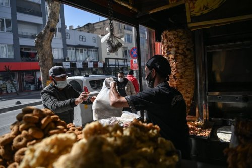 A Syrian buys food in a grill shop on February 25, 2021 in Gaziantep. [OZAN KOSE/AFP via Getty Images]