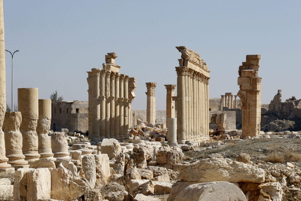 A picture shows the damaged Arch of Triumph and surrounding columns in Syria's Roman-era ancient city of Palmyra on February 7, 2021, in the country's central province of Homs [LOUAI BESHARA/AFP via Getty Images]