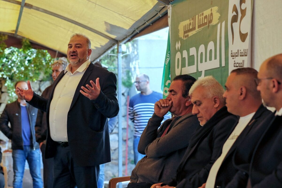 Mansour Abbas (R), head of Israel's conservative Islamic Raam party, speaks to a crowd during a political gathering to congratulate him on the electoral victory in the northern Israeli village of Maghar on March 26, 2021 [AHMAD GHARABLI/AFP via Getty Images]
