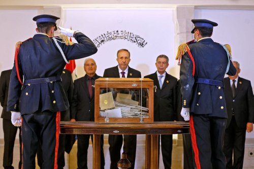 The Supreme Constitutional Court, the highest jurisdictional authority in Syria, receives the ballot box containing the votes of the country's Parliament members for the candidates of the upcoming presidential elections, in the capital Damascus, on 29 April 2021. [LOUAI BESHARA/AFP via Getty Images]