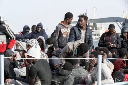 Migrants arrive at the naval base in the Libyan capital of Tripoli on April 29, 2021 [MAHMUD TURKIA/AFP via Getty Images]